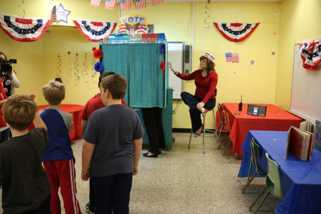 Students at Benjamin Franklin Elementary School wait in line to vote for president.