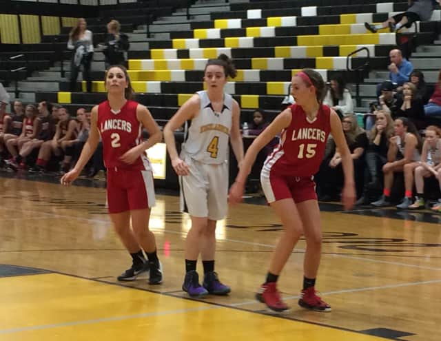 If you want to work on your rebound skills -- like West Milford's Brielle Mulvihill has, shown here waiting for a chance to rebound against Lakeland -- sign up for the West Milford's rec department basketball clinics.
