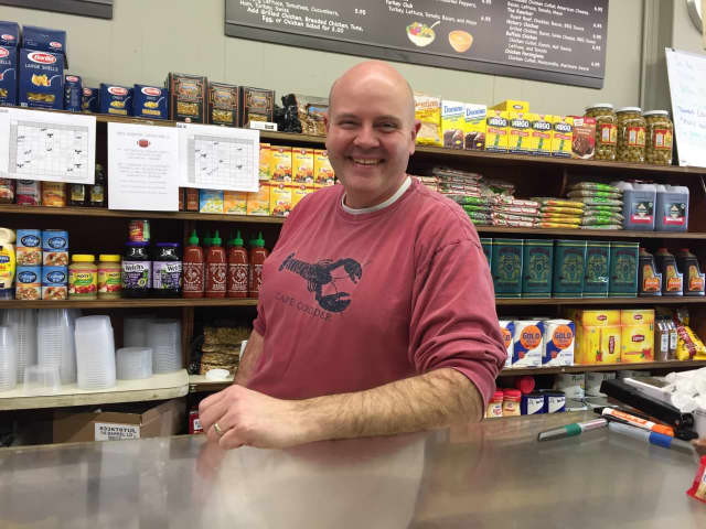 Craig Brenkert keeps business running with Mike Charalmbous at Schreiber's Deli in Oradell.