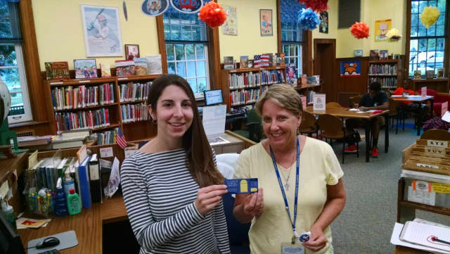Children's librarians Alicia Celentano, left, and Amy Sears promote Library Card Sign-Up Month.