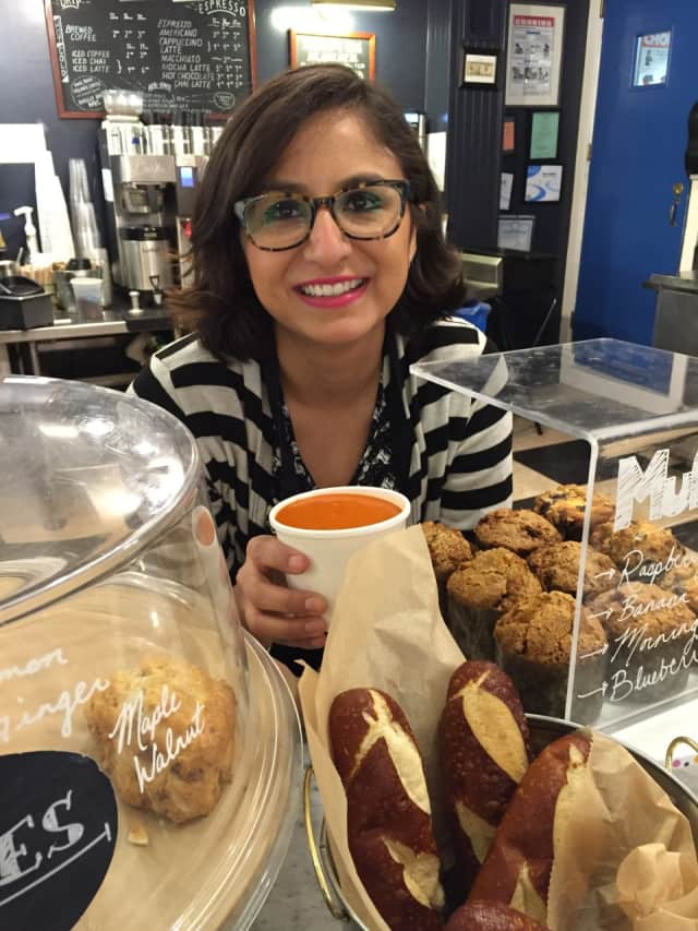 Reading Room's Assistant Manager Suseth Garcia holding the creamy tomato soup.
