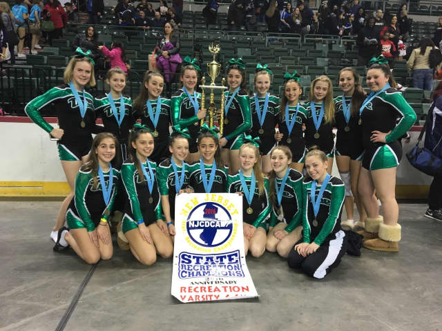 Pascack Valley Tribe hoists the championship trophy.