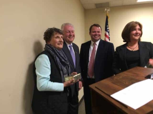 Last year's Fairfield Employee of the Year Janet Merando (left) is congratulated by First Selectman Michael Tetreau, Selectman Christopher Tymniak and Selectman Laurie McArdle.