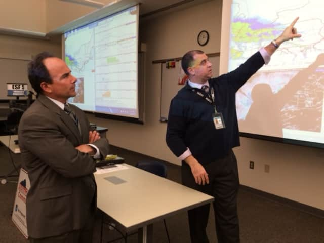 Scott Appleby, director of Bridgeport's Emergency Operations Center, (right), shows Mayor Joseph P. Ganim the latest wether predictions for an overnight storm.