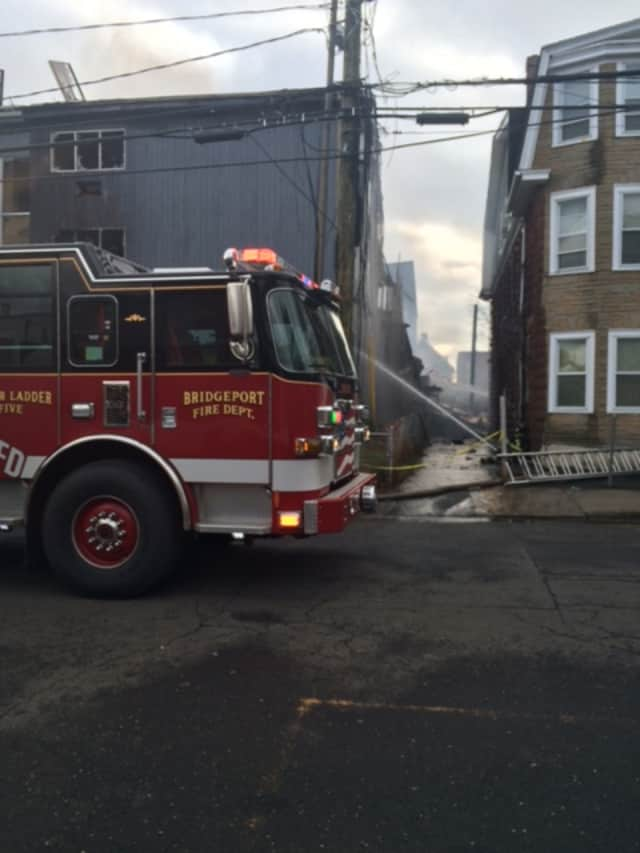 The rear of an apartment building collapsed at 215 Charles St. in Bridgeport during a New Year's Eve fire.
