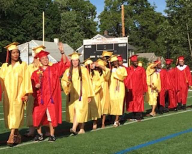 Graduates wave to their families at a recent Stratford High School commencement.