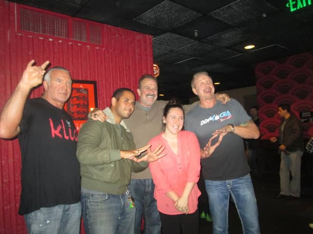 "Wrestling fans pose with Scott Hall, Jake ""The Snake"" Roberts and ""Diamond"" Dallas Page at The Alamo Drafthouse in Yonkers."