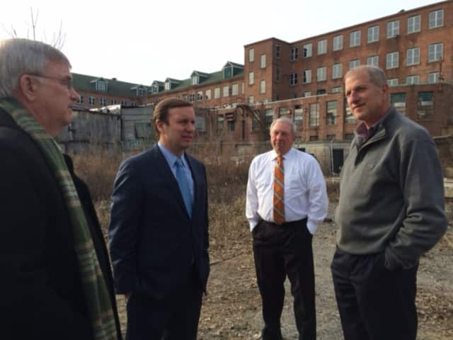 James Ryan, president, Shelton Economic Development Corp., U.S. Sen. Chris Murphy and Shelton Mayor Mark Lauretti, far right, discuss the city's waterfront brownfields in which the city won an earlier $200,000 EPA grant.
