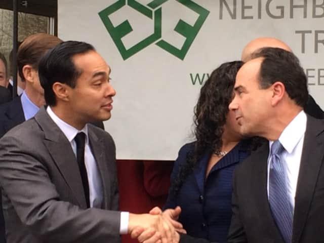 HUD Secretary Julian Castro shakes hands with Bridgeport Mayor Joseph Ganim at the opening of Milestone Apartments last week. Thursday, he awarded the city $38 million in HUD funding.