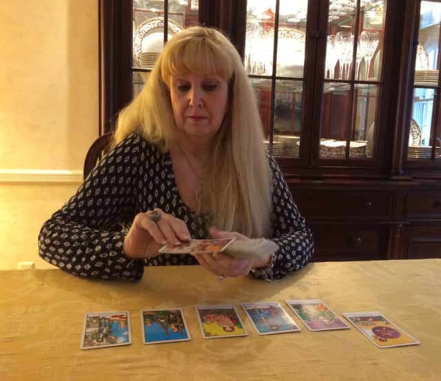 Cindy Muni lays her cards on the table of her Wyckoff home.
