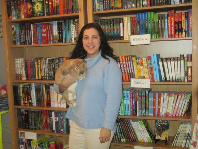 Laura Schaefer, owner of Scattered Books in Chappaqua, with her pet rabbit.