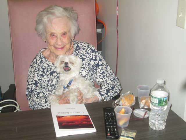 Audrey Rodgers, with her dog Mikey, has recently published her memoirs.