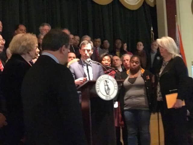 New Rochelle Mayor Noam Bramson, center, details residents' frustrations with utility company response to blackouts. Westchester County Executive George Latimer, left, called the news conference Friday at the County Center.