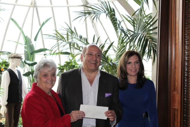 L-r: Lockwood-Mathews Mansion Museum board chairman Patsy Brescia, Klaff's CEO Joe Passero, and the museum's executive director, Susan Gilgore, show off the check for $8,811.90 that the design firm donated to the museum