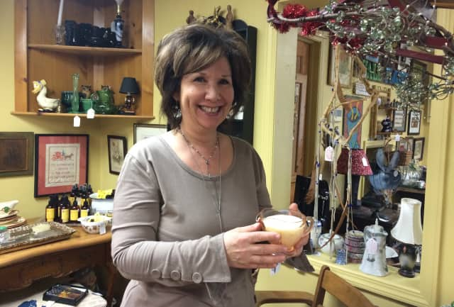 Trinkets and antiques surround Lori Pickail at her Ringwood store Wallflower Antiques.