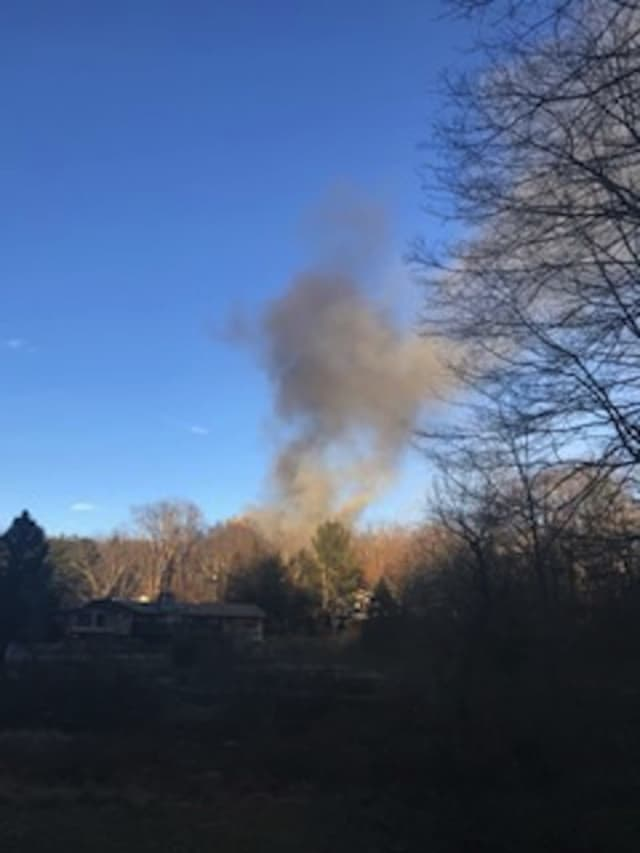 A view of the house fire from nearby.
