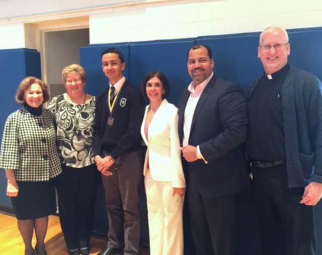 (from left to right) Superintendent for Catholic Schools Dr. Margaret Dames, Visitation Academy Principal Ms. Kimberly Harrigan, Ethan Cabral and his parents and Fr. Eugene Fields, Pastor of Our Lady of the Visitation Parish, in Paramus