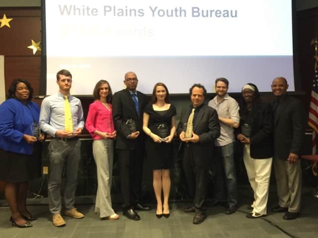 Students and teachers from White Plains accept STEM awards.