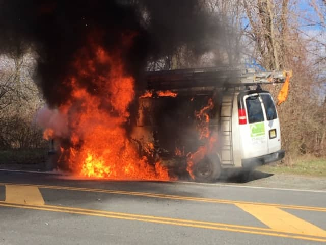 Neither the driver nor the passenger knew their van was on fire and walked away from the scene without injuries, thanks to the lieutenant's quick action.