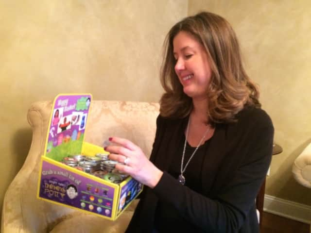 Paulette Laurenzi browses through some of the toys she offers at Spring Lake Toys in Wyckoff.