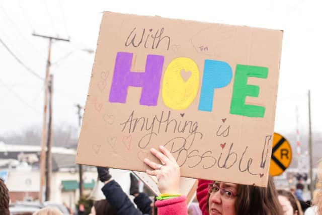 A participant holds a sign during the peaceful rally in Wyckoff organized by Women for Progress.