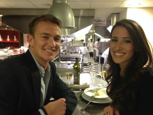 Ryan Brining and his fiancee, Emily Battersby, enjoy a meal together.