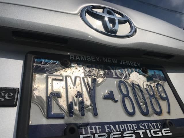 Gov. Andrew Cuomo thinks 10-year-old plates are an eyesore. So he wants all motorists to buy new New York license plates starting in April.  This faded edition is prone to peeling, making it more difficult to read by EZ-Pass and law enforcement.