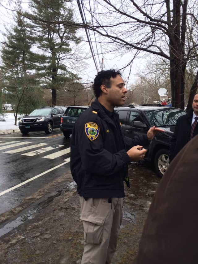 Fairfield Police Lt. James Perez talks to reporters outside 22 Mountain Laurel Road, where a violent domestic attack left one person dead.