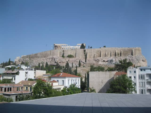The Acropolis topped by the Parthenon as seen from the Acropolis Museum, Athens. Photograph by Georgette Gouveia.