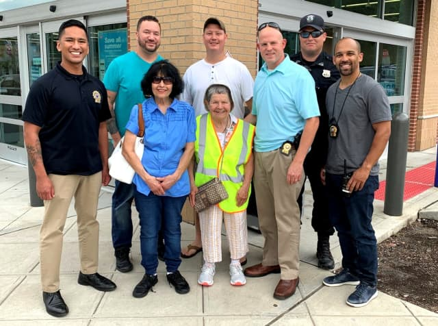 (l. to r.): With Patty and her sister, Susie, are Teaneck Police Detectives Michael Sunga and Ronald Boswell, Officer James Hoover, Detective Lt. Seth Kriegel, Officer Craig Luebeck and Detective Sgt. Michael Moliere