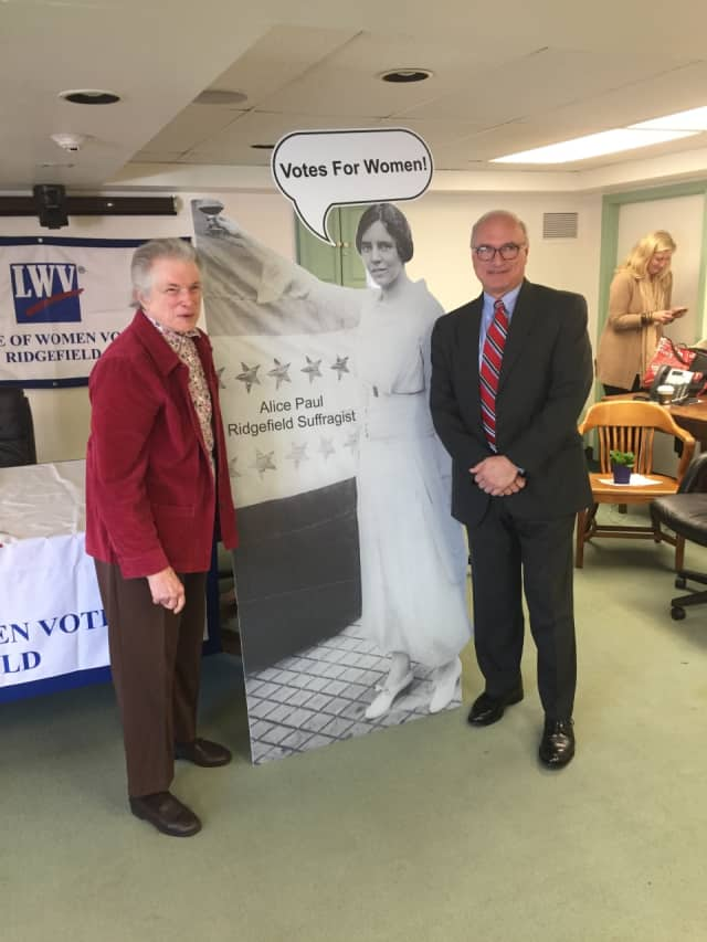 Ridgefield resident Josette Williams stands next to Ridgefield First Selectman Rudy Marconi following her talk on Alice Paul, a Ridgefield suffragist.