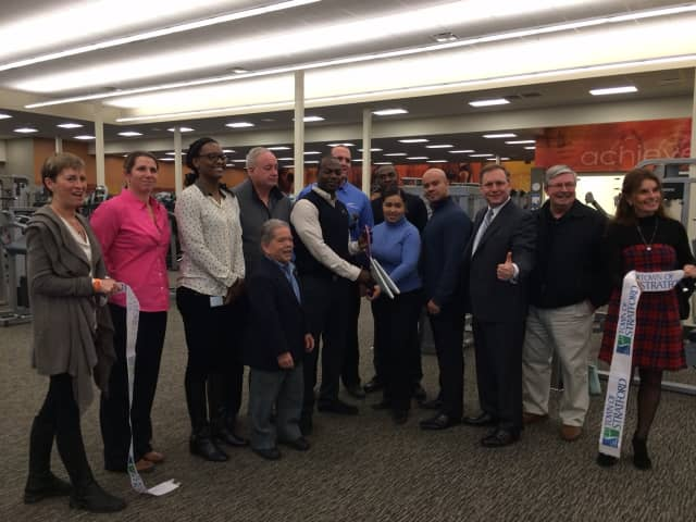 Staff and town officials cut the ribbon at the new LA Fitness in Stratford.
