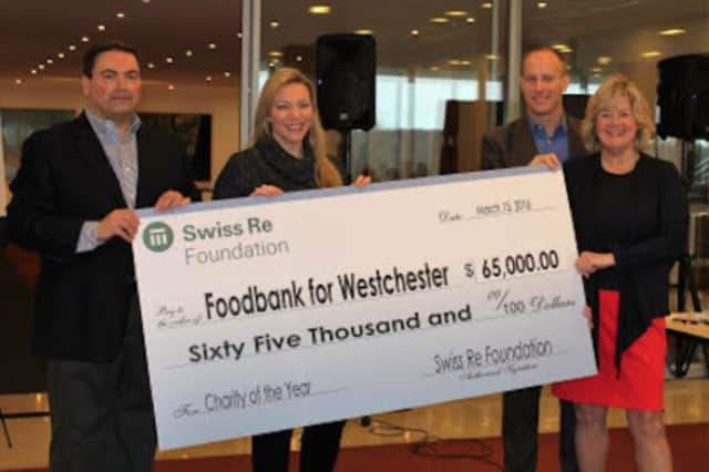 From left, Nicholas Penn, vice president at Swiss Re; Maria Bronzi, board chairperson of Food Bank for Westchester, Neil Sprackling, managing director at Swiss Re; and Ellen Lynch, chief executive officer of Food Bank for Westchester.