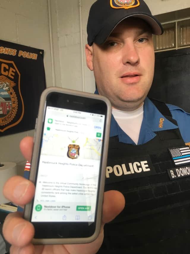 Hasbrouck Heights Patrolman Brian Donohue has the NextDoor app on his phone.