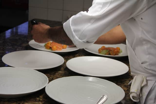 Plating food at Equus Restaurant, which has Thanksgiving specials.