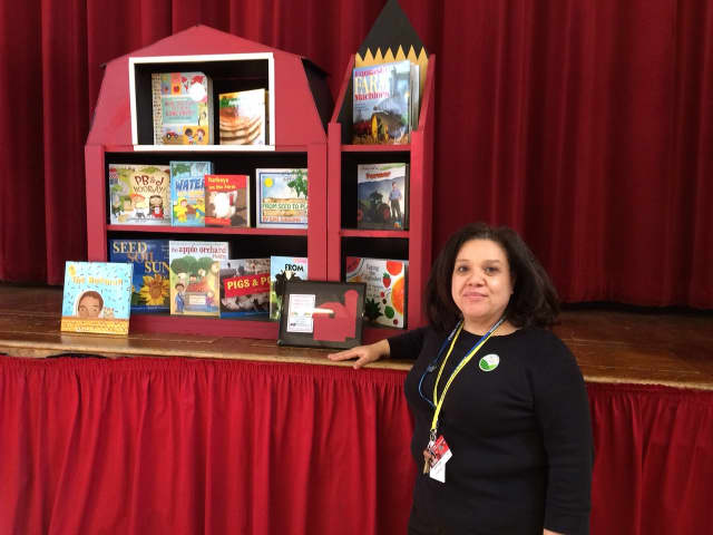 Librarian Lissette Valle will add the new barn bookcase to Park City Magnet School's library.
