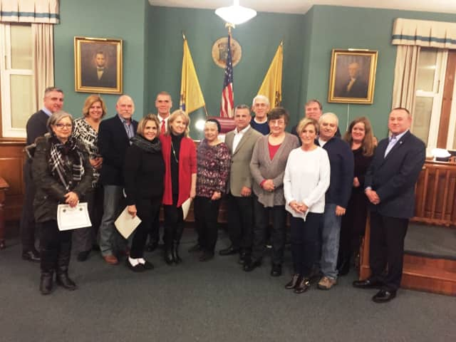 The Rutherford Mayor and Council, Lions Laura O'Connor and the 2015 Holiday decorating contest winners gathered after receiving the awards at the February Borough Meeting.