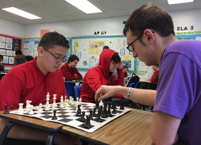 Elmwood Park freshman James Piereschi, at left, and senior Matt Tester play chess at the high school's club meeting.
