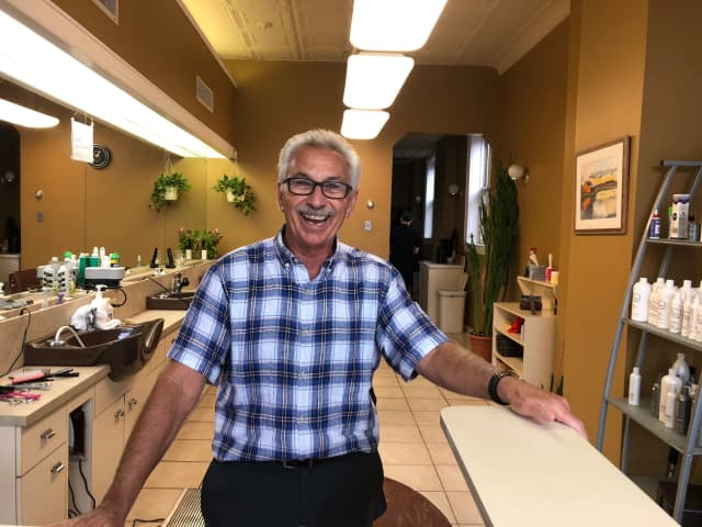 "Lorenzo ""Larry"" Lavorgna is celebrating 50 years at Fifth Avenue Haircutters in Teaneck."