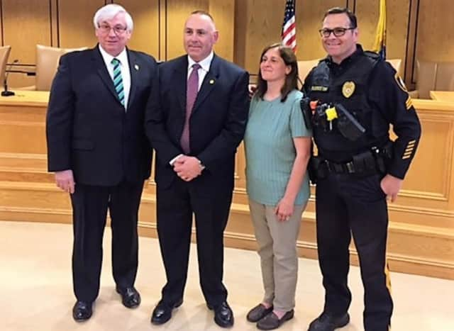 (From left:) Mahwah Mayor William Laforet, Detective Gerald Falotico, wife Sharon Falotico, brother Ramsey Police Sgt. Richard Falotico