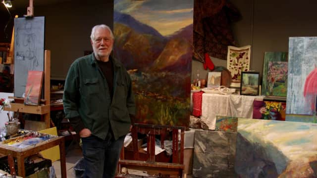 Max Horbund poses with a landscape painting in a similar style to what he intends to demonstrate on Nov. 17.