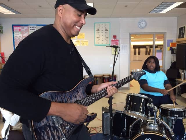Yankees legend Bernie Williams jams with students at Tisdale School on March 7.