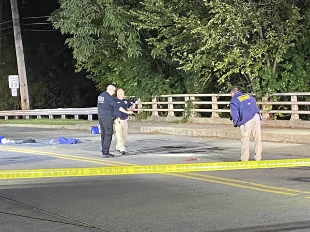Investigators at the scene of the bicycle/SUV crash on East Ridgewood Avenue near the Paramus border.