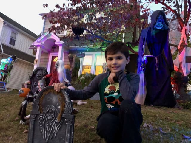 Brody, 9, creates what might be the most haunted Halloween display in Westwood every year in his front lawn.