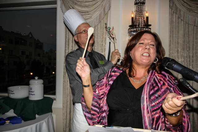 People to People executive director Diane Serratore and Nyack resident John Patrick Schutz, and entrant, ham it up at past Get Saucy! event. This year's fundraiser will be Thursday, Oct. 6 at Nyack Seaport.