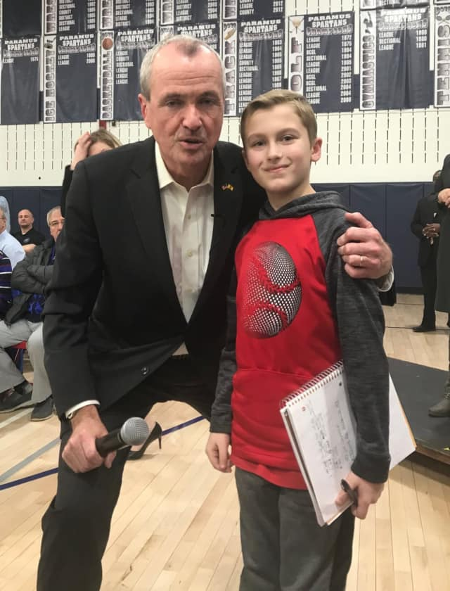 Jack, a fifth grader at West Brook Middle School, asks Gov. Murphy his opinion on PARCC testing Wednesday.