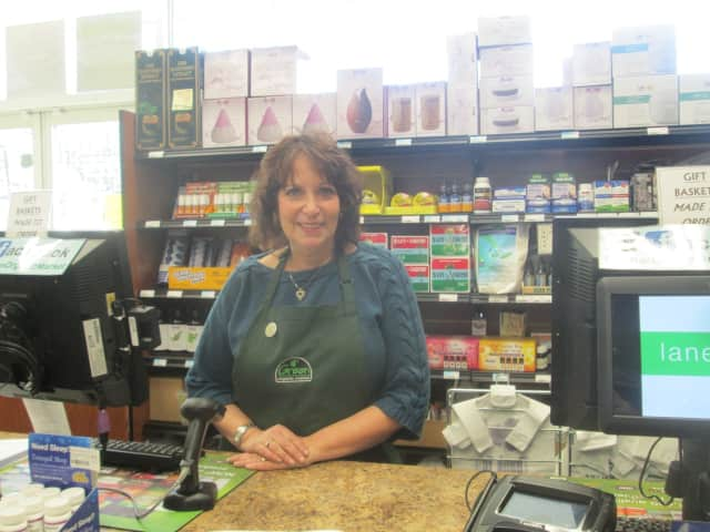 Janice Zaiman helps customers at Green Organic Market's supplement store in Hartsdale.