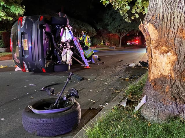 The vehicle slammed into a tree and rolled onto its side near the intersection of Linwood Avenue and North Walnut Street in Ridgewood.