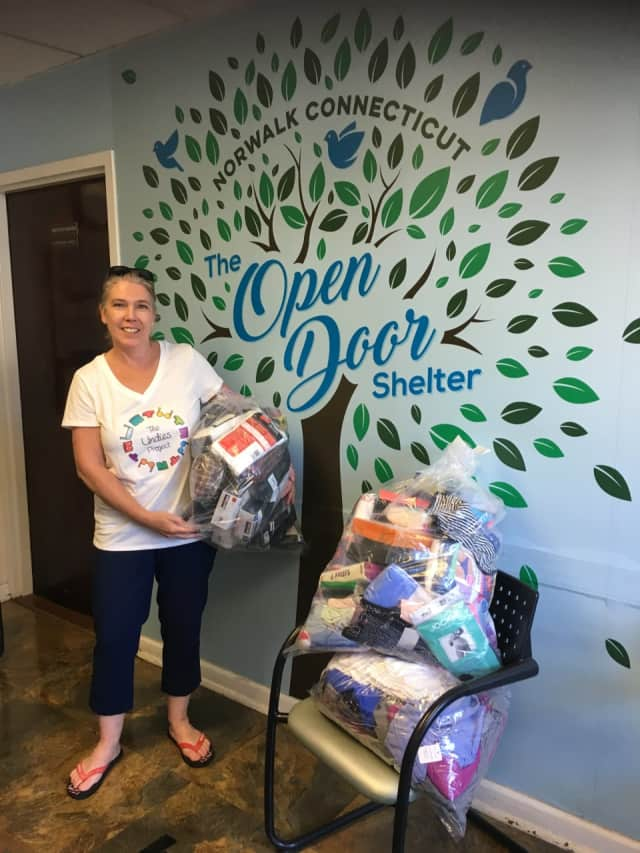 Lucy Langley, of The Undies Project, delivers donations from Undie Sunday to Open Door Shelter in Norwalk.