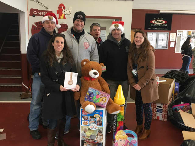 Katie Miller, left, and Janine Cook, right, collect toys for The Valley Hospital during last year's Bergen County PBA Toy Drive.
